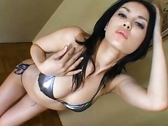 Maria Ozawa Asian plays with her tits and ass in silver lingerie