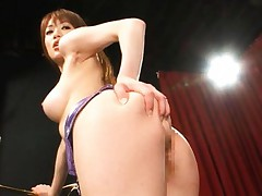 Akari Hoshino Asian with mauve latex skirt is doggy style nailed