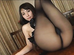 Yuka Osawa Asian in black dress and stockings spreads sexy legs