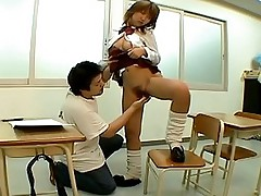 Horny Asian babe in uniform gets her tits fondled and pussy fucked in the class
