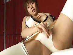 Yuma Asami plays with her pussy as she wears sexy pantyhose and lingerie