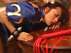Japanese AV Model with kinky bracelets is doggy nailed over table