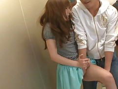 Rio Asian bitch has beaver rubbed and strokes cock in elevator