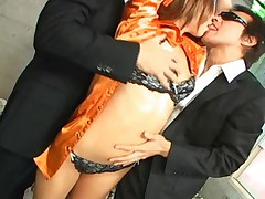 Misa Tsuchiya Asian babe is enjoying two guys fondling her tits