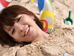 Japanese AV Model in bath suit is all covered in sand at the sea