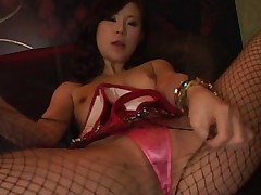 Japanese AV Model with broken fishnet rubs pussy over pink thong