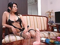 Asian slut in black lingerie and fishnets and heels gets her pussy pounded hard