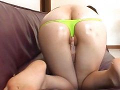 Chihiro Kawaoka with green lingerie sticks oiled finger in crack