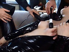 Ai Haneda gets vibrators on cans and pussy under latex jumpsuit