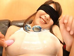 Hitomi Kitagawa in wet bath suit and with eyes covered is aroused