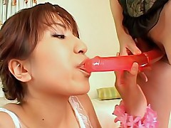 Lovely Asian lesbos play with a double dildo before fucking their dates
