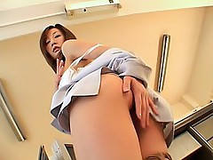 Asian secretary happily shows off her nice big tits and pussy