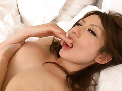 Reon Otowa Asian with juicy melons licks her fingers erotically