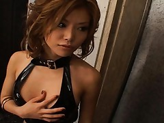 Akane Hotaru in a shiny black outfit showing off her sexy tits