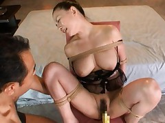 Mako Oda Asian with huge cans is fucked with dildo and fingers