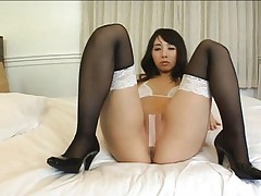 Yuka Osawa Asian in stockings touches cunt over band stuck on it