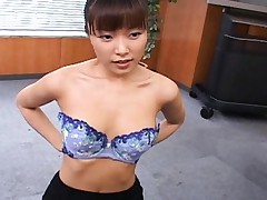 Yua Aida removes her shirt and bra to show off her sexy tits