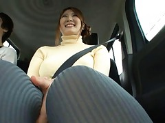 Momoka Nishina Asian in long socks rubs her clit inside the car