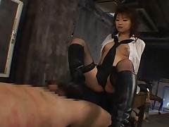 Akane Sakura sexy mistress putting wax on her male slave