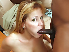 Hot wife Nicole Moore mouthfucks a black cock and goes for a raunchy interracial fuckfest live
