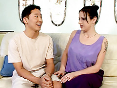 top heavy wife Moxie Madden smothers an Asian guy with her boobies and gets cock plugging live