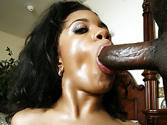 Slutty ebony beauty Stacey Cash gags on a supersized dong and got butt fucked and gooed live