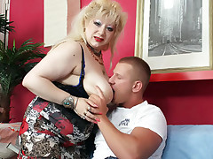 Chubby blonde mature Zhanna flaunts her big jugs and got her pierced cunt eaten and screwed live