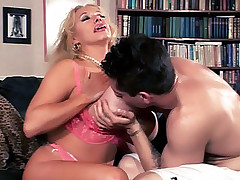 Blonde housewife Echo Valley shows off her enormous racks and lures a younger guy into fucking her