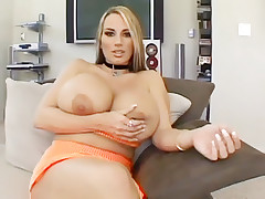 Blonde housewife Lisa Lipps welcomes us into her living room by showing off her huge boobies live