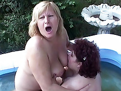 Watch these BBW lesbians Sue Ann and Amanda captured pussy lickiing live in the pool
