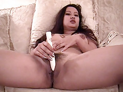 Plump Asian Coco Liu warming up her cooze with a dildo and gets balled in this live Asian sex scene