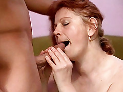 Mature redhead Stella sucks an enormous cock until it is ready to fuck her boobs live