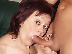 Experienced mature redhead Paula taking a fat cock in her bushy snatch and cum gets glazed live