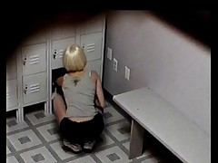 This sporty blonde doesn't know she's being spied on as she changes in a locker room