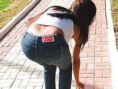 Long haired Latina gets caught on film in skin tight denim jeans