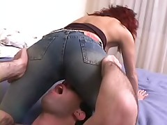 Busty redhead wearing a tight blue jeans gets deep anal fucked hard