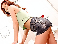 Tall slender redhead in miniskirt lets guy tongue her pink pussy