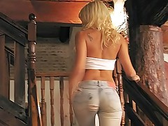 Blonde wearing a ripped tight jeans gets licked and back fucked