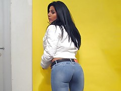 Busty brunette wearing a tight jeans exposing her ass