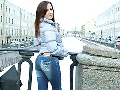 Tight blue jean wearing brunette gives cock access to her holes