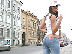 Brunette wearing blue jeans swallows a large stiffy cock