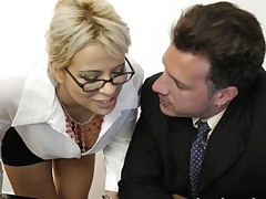 Busty secretary sucks boss cock and gets fucked in doggy style
