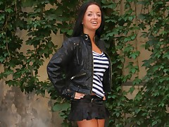 Hot Brunette in black skirt slides a massive dong in her tight snach