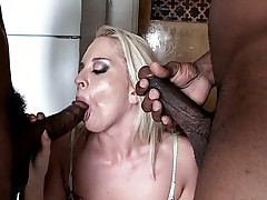 Blonde babe Simone Schiffer gets herself double penetrated by two big black cocks
