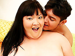 Lusty Asian BBW gets her large knockers pleased and receives a deep pussy humping from a hunk