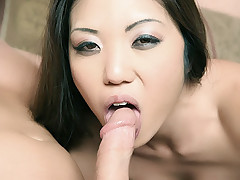 Pretty Asian sexpot Kaiya Lynn spreading her pussy lips wide while a hunk pounds her tight ass