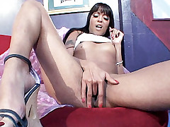Luscious ebony model Peaches sucking off a big cock before taking it in her cooze by humping on top