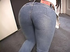 Beutifull brunette wearing tight blue jeans gets back fucked