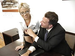 Horny boss gets a blowjob from busty secretary that gets fucked