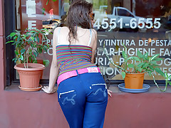 Sultry brunette shows off her small ass in sexy tight blue jeans
